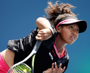 STANFORD, CA - JULY 28: Naomi Osaka of Japan serves to Samantha Stosur of Australia during Day 1 of the Bank of the West Classic at the Taube Family Tennis Stadium on July 28, 2014 in Stanford, California. (Photo by Ezra Shaw/Getty Images)