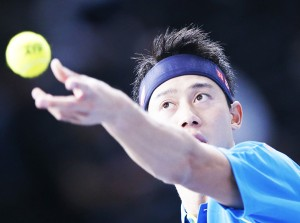 Japan's Kei Nishikori eyes the ball to serve France's Jeremy Chardy, during their second round match, at the BNP Masters tennis indoor tournament, at the refurbished Bercy Arena, in Paris, France, Wednesday, Nov. 4, 2015. (AP Photo/Francois Mori)