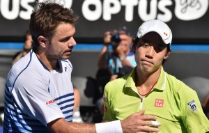 Switzerland's Stanislas Wawrinka (L) shakes hands as he celebrates after victory in his men's singles match against Japan's Kei Nishikori (R) on day ten of the 2015 Australian Open tennis tournament in Melbourne on January 28, 2015. AFP PHOTO / PAUL CROCK-- IMAGE RESTRICTED TO EDITORIAL USE - STRICTLY NO COMMERCIAL USE